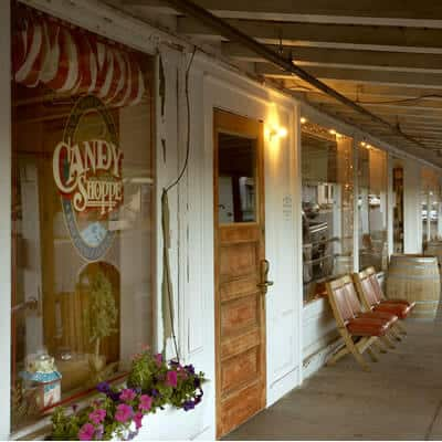 Exterior door on long covered porch leads to the Candy Shoppe.