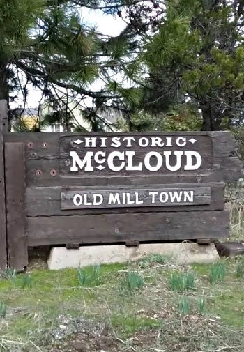 Aged wooden sign that says, Historic McCloud - Old Mill Town